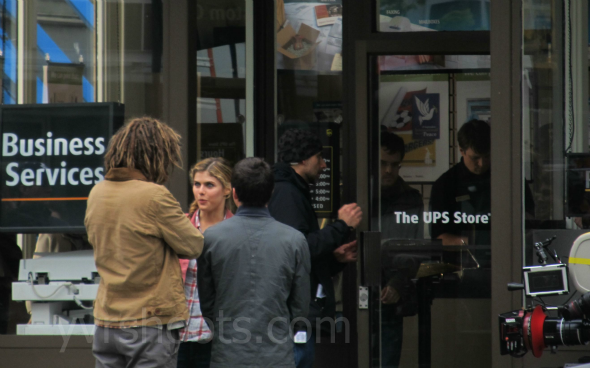 nathan fillion and the cast of percy jackson sea of monsters at the ups store set in vancouver. Black Bedroom Furniture Sets. Home Design Ideas